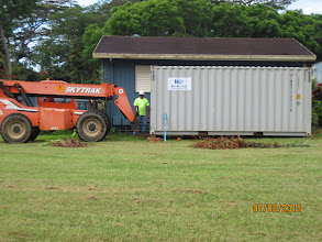 Photo: The contractors brought in a storage bin to house their equipment, supplies, and materials. This will save time so they can come straight to the work site and leave at the end of the day.