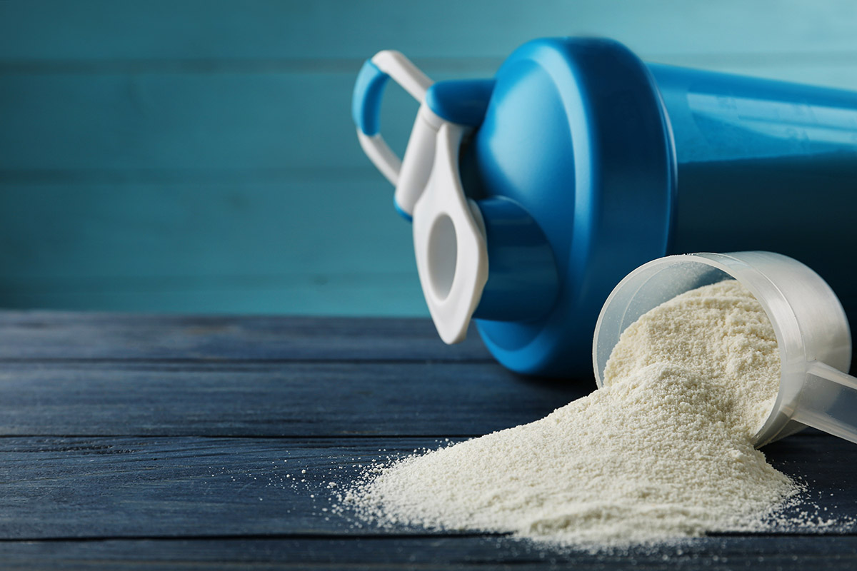Photo of a smoothie bottle and hydrolyzed whey protein powder