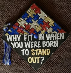 """A graduation cap that reads """"Why fit in when you were born to stand out?"""""""