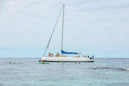 catamaran-on-roatan.jpg - A catamaran alights in the waters off Roatan Island, Honduras.