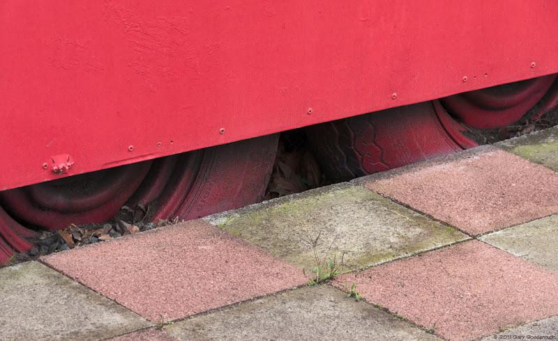 Photo: Two Tires Shot along the sidewalk—not the street side—in a Portland Oregon neighborhood.