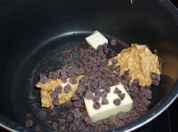 Melt butter, peanut butter and chocolate chip pieces in pan.just melt and blend..