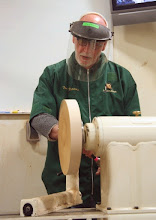 "Photo: Tom has some blanks of local soft maple prepared and mounted on a faceplate.  Here he trues the ""back"" side first."