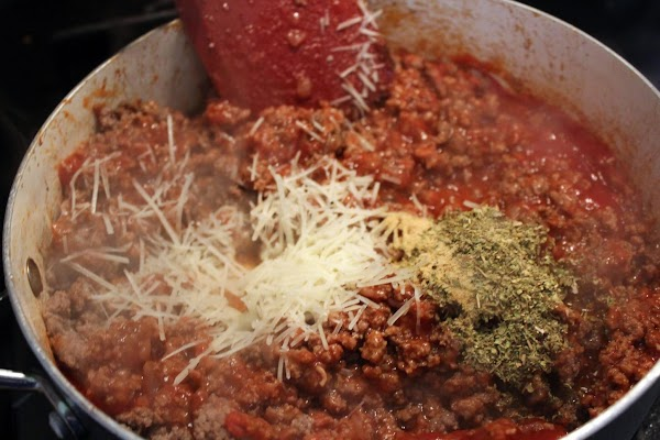 Cheese, catsup, and spices mixed into browned beef.