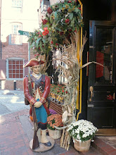 Photo: A wooden solider guarding a local food store along the Freedom Trail.