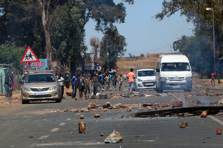 WATCH   Shots fired as police and protesters clash over evictions - SowetanLIVE