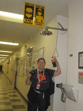 Photo: Annie at the hallway biohazard showers! Here's hoping we don't ever have to use one of these... !