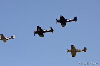 Photo: The finale of the Flying Legends Air Show with a huge formation of World War II fighters.
