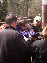 Photo: Emergency rescue workers help kayaker Anthony Ballsiger who dislocated his shoulder on the river.