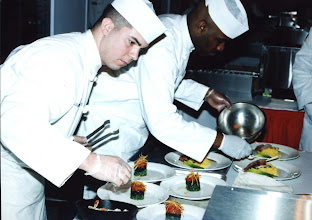 Photo: Pfc. Michael O'Quinn and Sgt. Jason Swazer compete in the Nutritional Hood Food Challenge during the U.S. Army Culinary Arts Competition at Fort Lee.  O'Quinn and Swazer are members of the U.S. Army Korea team.