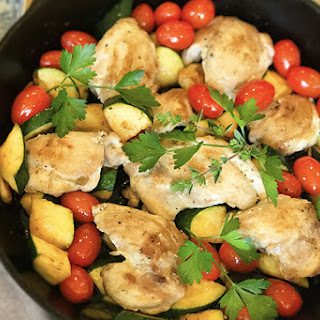 Chicken Thighs with Tomatoes and Zucchini.