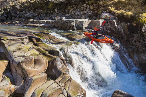 Whitewater kayaking on the River Etive in Glencoe, Scotland.