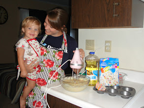 Photo: Heidi & Mommy mix it up - eggs, oil, water, & cupcake mix. Oh, and fancy aprons! Don't forget the fancy aprons.