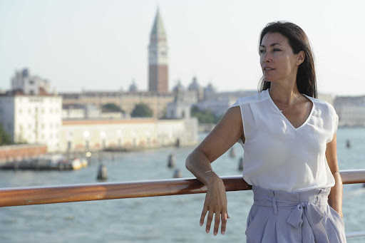 Ponant-Venice-woman-ship.jpg - Stroll the streets of Venice in style during a Ponant cruise.