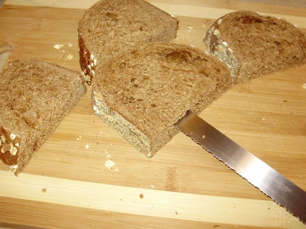 Taking the four halves of bread. Make slits in the bread. (This will be...