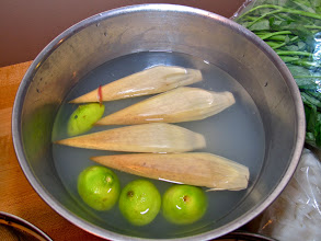 Photo: banana blossom trimmed of red petals, quartered and soaking in water with lime juice added