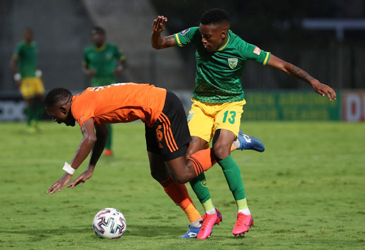 Thabang Monare of Orlando Pirates fouled by Pule Mmodi of Golden Arrows during the DStv Premiership 2020/21 football match between Golden Arrows and Orlando Pirates at Sugar Ray Xulu Stadium, Durban on 02 February 2021.