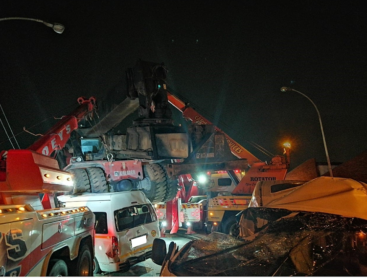 A crane fell off a truck onto two taxis and a car in Durban, killing one person and injuring at least 30 others.