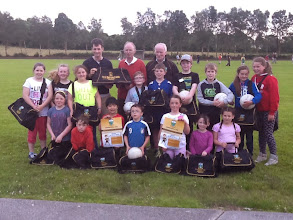 Photo: Michael Winters of Abbey Murphy, Longford presenting our underage players with new gear bags 2014