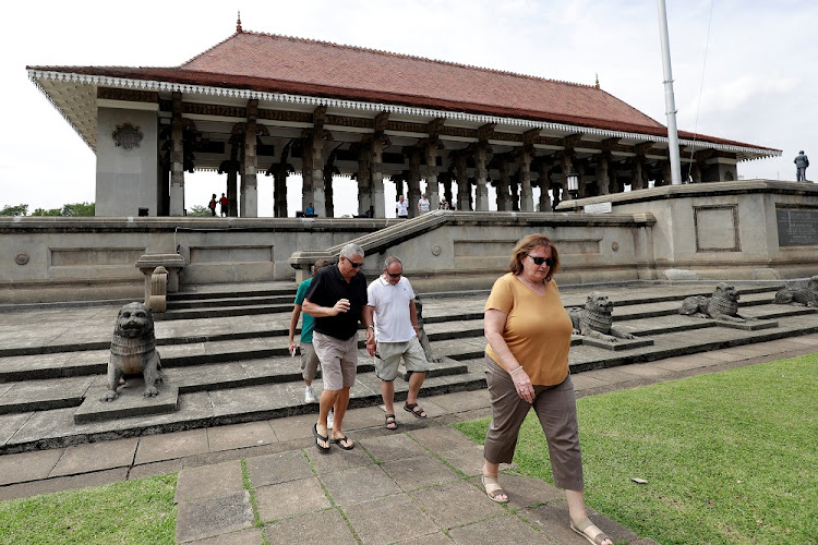 Tourists leave the Independence Square after a visit in Colombo, Sri Lanka, December 5 2018. Numbers have dropped amid political instability. Picture: REUTERS/DINUKA LIYANAWATTE