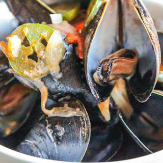 Mussels in a Tomato-Jalapeno Cream Sauce.