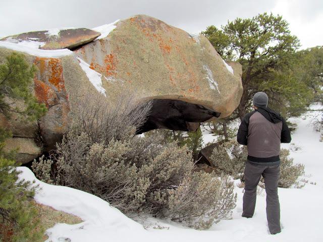 Overhanging boulder with pictographs inside