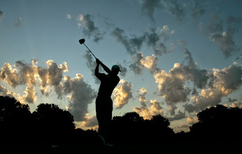 Photo: Tiger Woods tees off on the fourth hole during a practice round for the 89th PGA Golf Championship at the Southern Hills Country Club in Tulsa, Okla.,Tuesday, Aug. 7, 2007. The championship begins on Thursday, Aug. 9th. (AP Photo/Charlie Riedel)