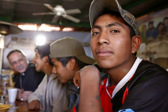 Photo: Jorge Alberto Pastrana, 18, from the Mexican state of Guerrero, waits for dinner to be served at the Aid Center for Deported Migrants in Nogales, Mexico, March 31. Dinner that evening was served by visiting U.S. bishops, including Auxiliary Bishop Luis R. Zarama of Atlanta, pictured at far left. The center, run by the Kino Border Initiative, was one stop the bishops made during their tour of the border area near Nogales. (CNS photo/Nancy Wiechec) (April 1, 2014)