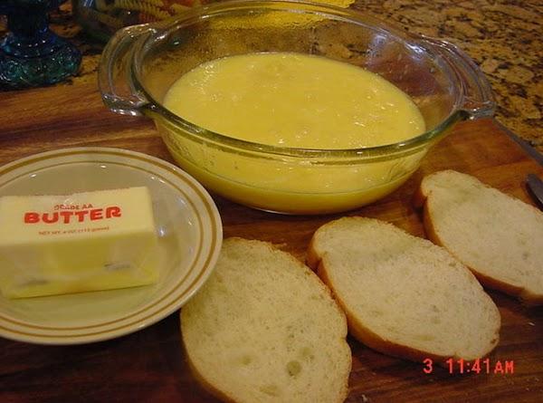 Spray a round 2 quart pyrex baking dish with Pam kitchen spray. Spoon the mixture...
