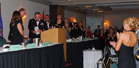 Photo: Soldiers, loved ones and families joined together for the gathering at the Marriott in Bloomington, Minn. on the night of Dec. 8th, 2007.  Dinner was served, awards were given to honor both Soldiers and families, distinguished speaker Chaplin John Morris (LT COL) gave a speech which received a standing ovation by the crowd and the night was turned back over to the Soldiers for a social hour.