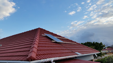 Photo: One solar panel fitted - I did not have enough solar cable to connect the remaining panels yet