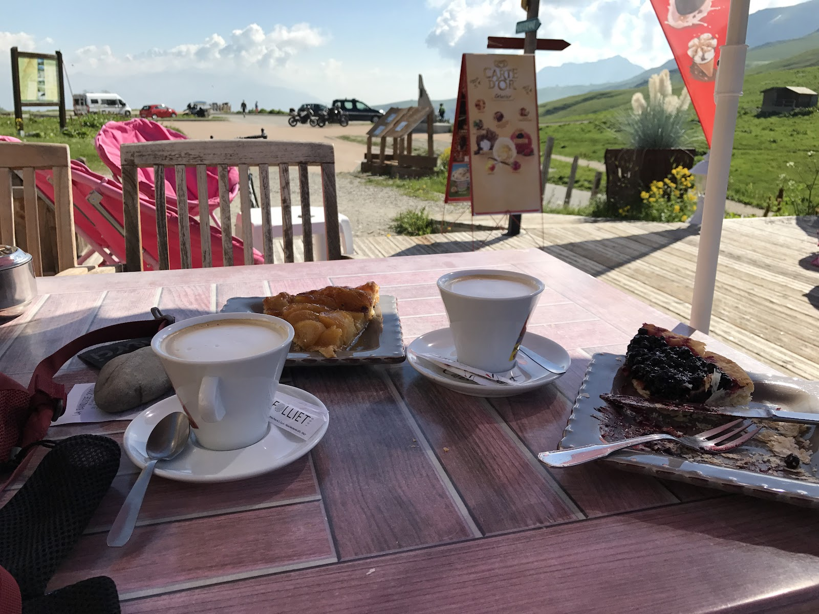 Cycling the greatest bike climbs in France - Col de Madeleine from La Chambre  - cafe with desert and cappuccino