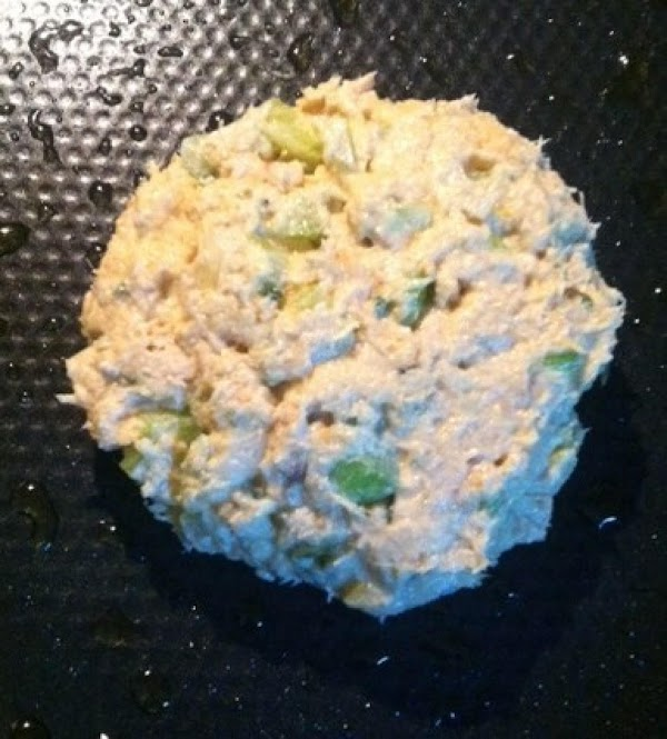 Take tuna and gently make in to a thick size patty to fit on...