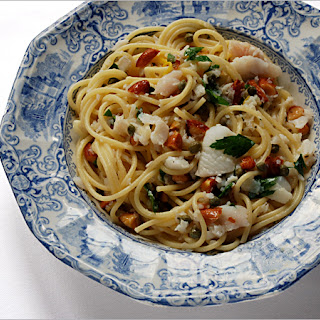 Spaghetti with Seafood, Almonds, Capers and Parsley.