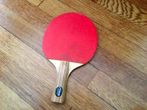 Photo: $3 Ping Pong Paddle, excellent condition and spongy. Reversible Black/Red