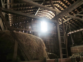 Photo: Barn window glowing with light above hay at Carriage Hill Metropark in Dayton, Ohio.