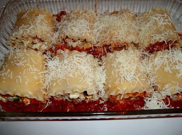 Sprinkle 1/2 cup mozzarella and 1/4 cup parmesan over the noodles.   Now, spread remaining sauce...
