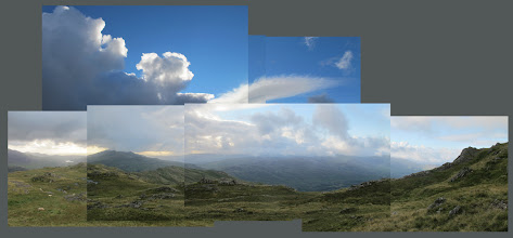 Photo: Snowdonia; tried to capture scale by extended photographs of cumulus clouds above mountains)