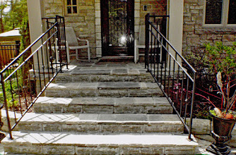 Photo: Horrid concrete steps disappear under this lovely square-cut flagstone.