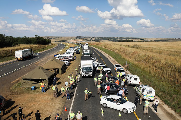 Police pull over cars at a roadblock on the N4 towards Pretoria on Friday last week.