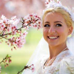 Young Bride In Field of Cherry Blossom Trees by Kim Wilson - Wedding Bride ( person, photograph, single, exterior, veil, people, spring, happy, sunny, woman, lifestyle, gown, pink, flowers, smiling, cherry blossoms, 20s, green, white, image, bloom, adult, young, bridal, female, dress, wedding, horizontal, outdoors, trees, outside )
