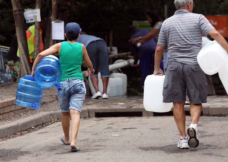 Capetonians flock to the spring water point in Newlands after the city announced stricter water restrictions.