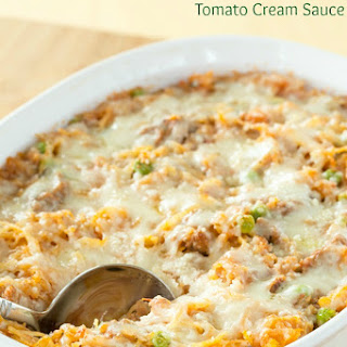 Baked Spaghetti Squash with Spicy Sausage Tomato Cream Sauce