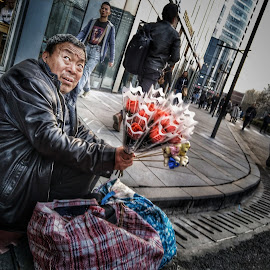 Do you want some roses sir? by Francisco Little - Instagram & Mobile Android ( china, vendor, beijing, roses, street photography, street vendor )