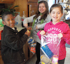 Photo: Kenny, Ava and Chloe packing kare kits! March 2013.