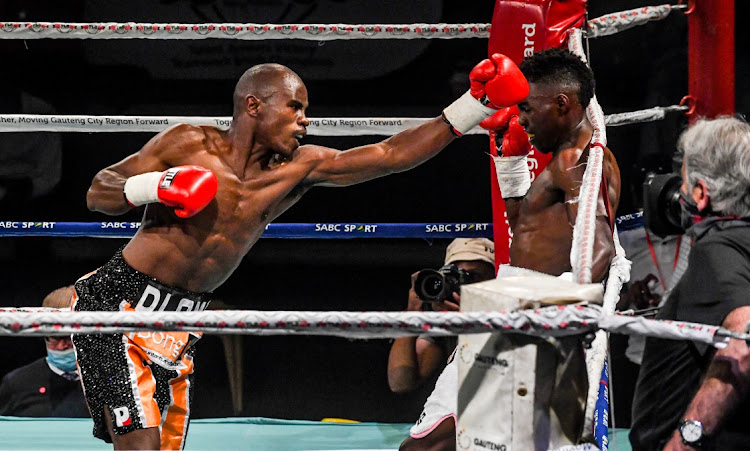 Prince Dlomo in action against Xolani Ndongeni during the Still Alive and Punching Tournament at Klipspruit Sports Centre on October 17, 2020 in Johannesburg.