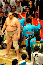 """Photo: Baruto, one of the top Ozeki (champions), compared to a """"normal"""" sized person."""