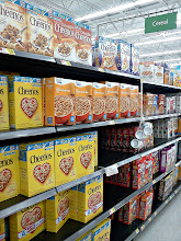 Photo: After dragging myself away from the delicious displays of Christmas candies & gifts, I went to find my box of Cheerios. The aisles are always clearly marked, so it was easy to find!