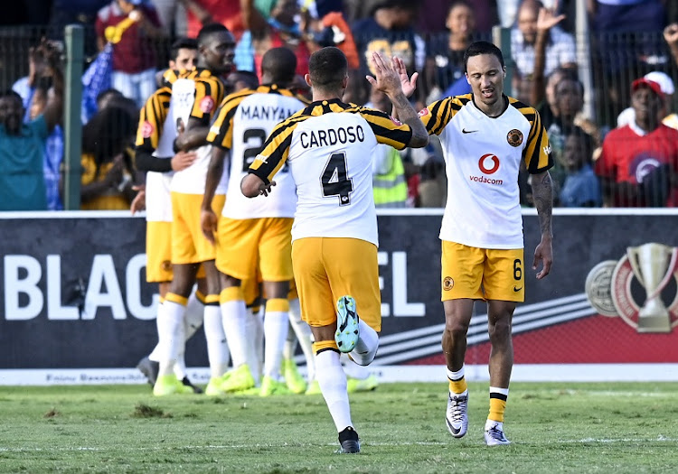 "Daniel Cardoso of Kaizer Chiefs FC ""High Fives"" team mate Kearyn Baccus after Kaizer Chiefs scored during the Absa Premiership 2019/20 football match between Amazulu and Kaizer Chiefs at King Zwelithini Stadium on 24 September 2019."