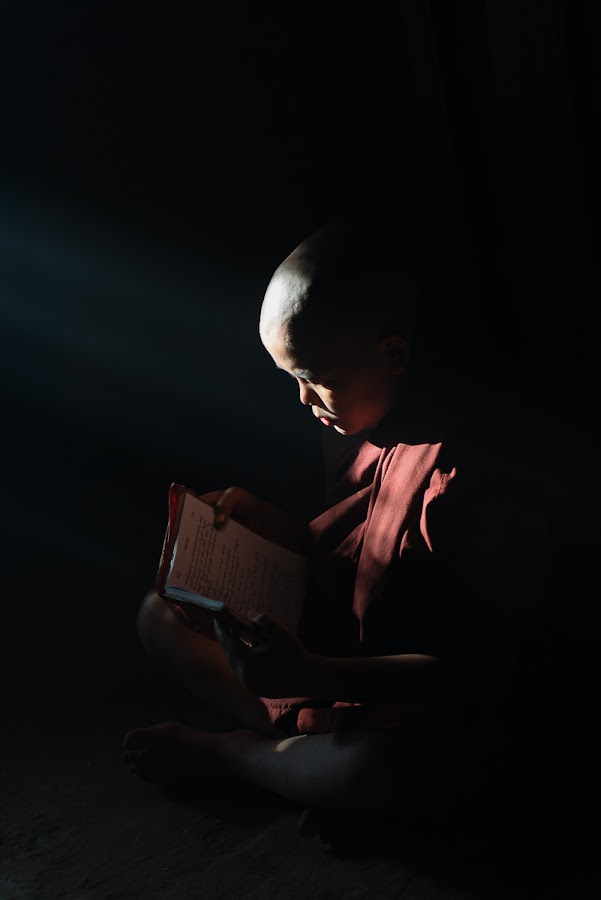 Learner under available light by Tin Htoo Khaing - People Portraits of Men ( myanmar, buddhism, novice, study, bagan )